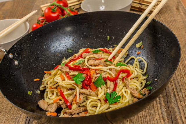 Chinese traditional food noodles with chicken meat and vegetables